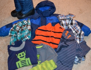 Eight items of kid clothing purchased at a consignment store. Simpler and more economical.